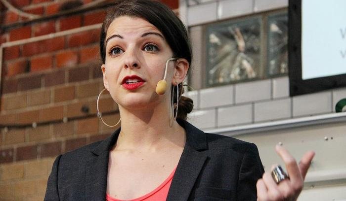 Anita Sarkeesian speaking at Media Evolutions The Conference 2013.